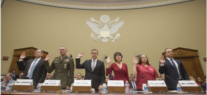Witnesses are sworn in before the House committee on Friday: from left, Assistant Secretary of Defense Michael Lumpkin, Major General James Lariviere, Homeland Security Inspector General John Roth, Assistant Secretary for Preparedness and Response Nicole Lurie, co-president of National Nurses United Deborah Burger and Rabih Torbay, senior vice president at the International Medical Corps.  Michael Reynolds